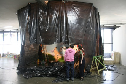 The+mural+gets+underway+in+the+improvised+spray+booth