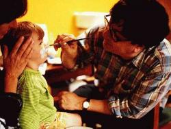 Artist Mark Wallinger conducted face-painting sessions, 2000