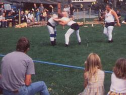 Cumbrian wrestling with artist Chris Helson, on the showground at the Grizedale Visitor Centre, 2000
