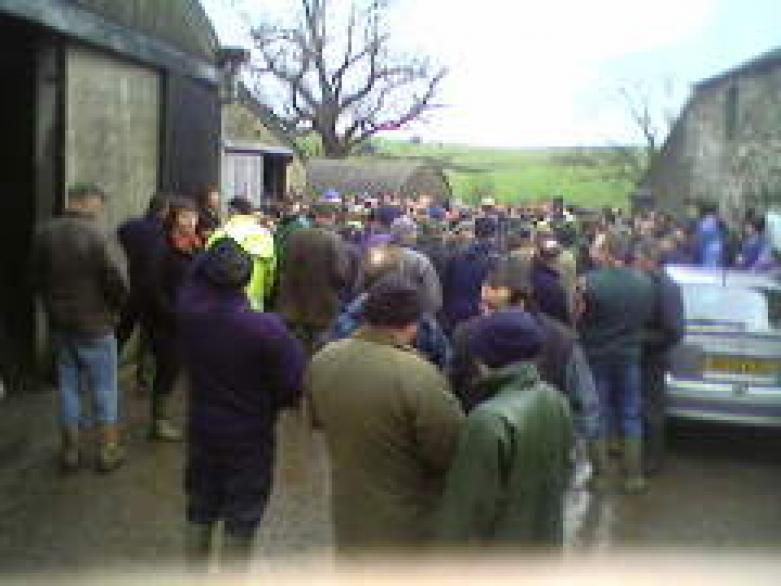 massed farmers considering the merits of a roll of barbed wire